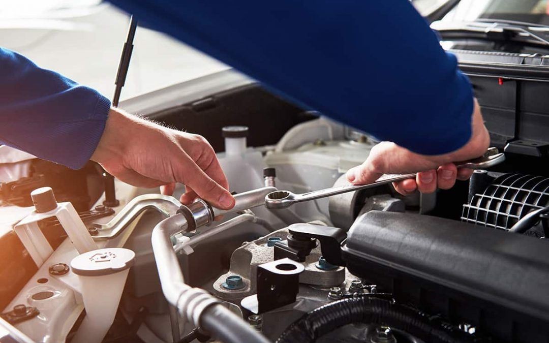 hands-of-car-mechanic-with-wrench-in-garage